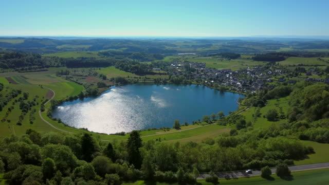 View across Schalkenmehren Maar towards the Town of Schalkenmehren, Vulkaneifel, Eifel, Rhineland-Palatinate, Germany