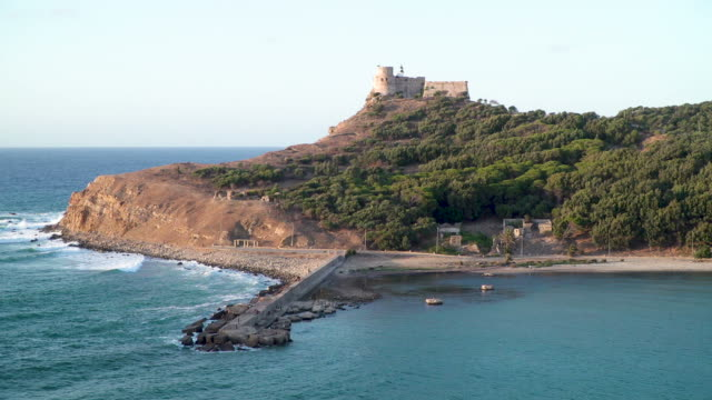 view across the bay to tunisian town of tabarka and castle - tunisia video stock e b–roll