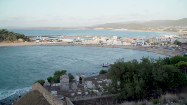 view across the bay to tunisian town of tabarka and castle - tunisia stock videos & royalty-free footage