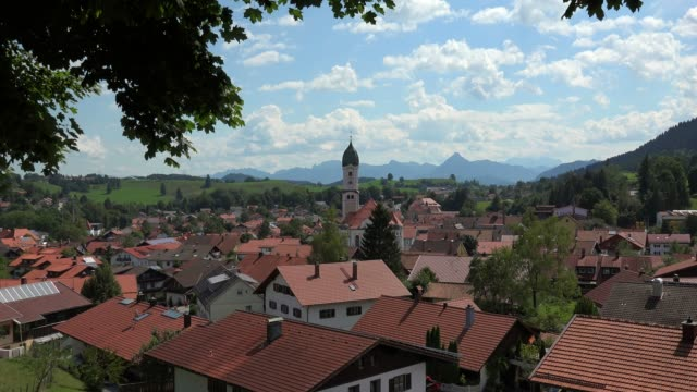 view across the town of nesselwang, allgaeu, swabia, bavaria, germany - xvii° secolo video stock e b–roll