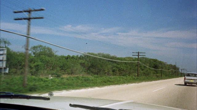 vídeos de stock, filmes e b-roll de ms pov view along highway in open country - 1960