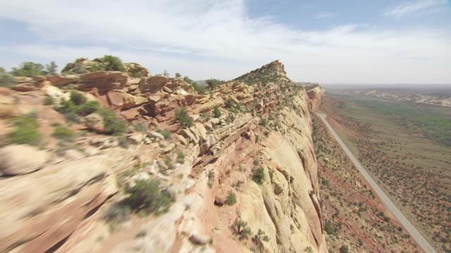 cu aerial view along ridge of colorado plateau near butler wash ruins / utah, united states - colorado plateau stock videos & royalty-free footage