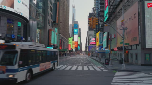 view along the deserted 7th avenue toward times square one of the busiest streets in nyc is now empty even during the morning rush hour and the... - unemployment covid stock videos & royalty-free footage