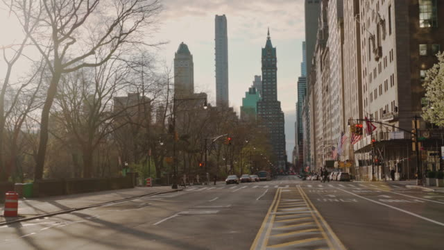 view along west 59th street nearby central park towards the plaza hotel. the city is deserted because of quarantine during the covid-19 pandemic. - quarantena video stock e b–roll
