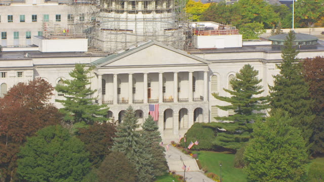 ws zo aerial pov view american flag waving at maine state house entrance/ augusta, maine, united states - augusta maine stock videos & royalty-free footage