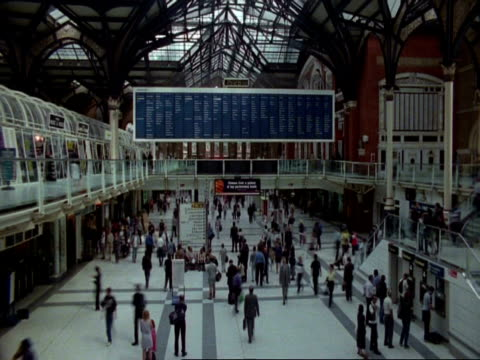 T/L WA view angle view of people moving around Arrival hall, Liverpool Street Station, London, Metal and glass roof