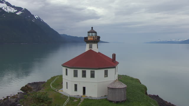 ms aerial view approach and fly over eldred rock lighthouse to lynn canal waterway / alaska, united states - juneau stock videos and b-roll footage