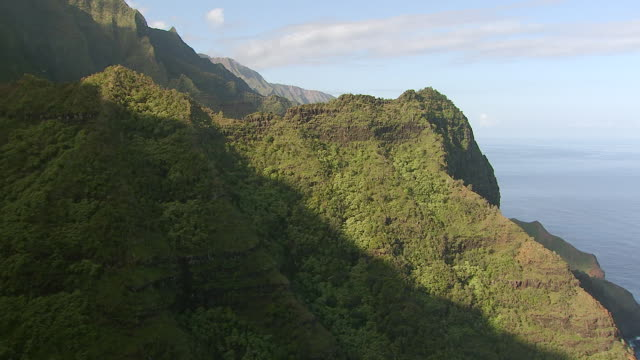 WS AERIAL View approaching along mountain side of napali coast on island of Kauai / Hawaii, United States