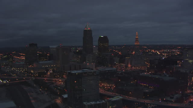 ws aerial view approaching downtown buildings / cleveland, ohio, united states - cleveland ohio stock videos and b-roll footage