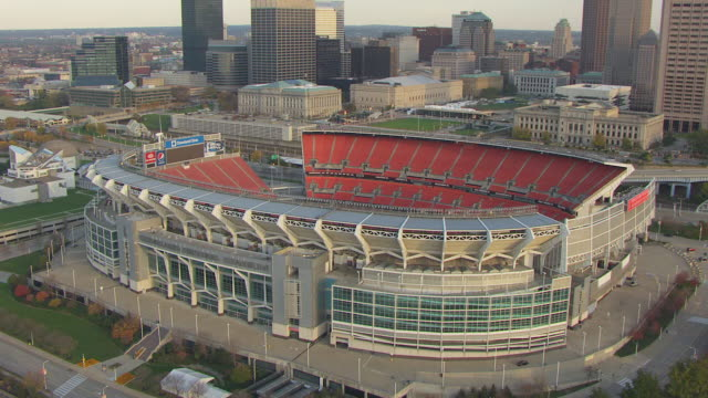 ws td aerial view approaching over firstenergy stadium / cleveland, ohio, united states - cleveland ohio stock videos and b-roll footage