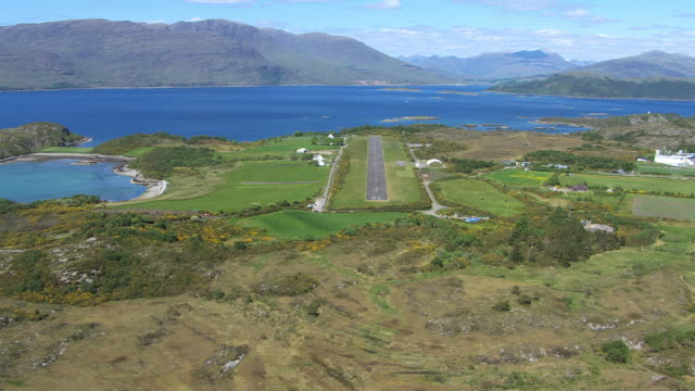 ws aerial view approaching small airstrip runway in idyllic coastal location at plockton on west coast / plockton, inverness shire, scotland - inverness scotland stock videos & royalty-free footage