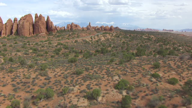 ws aerial view approaching to klondike bluffs in arches national park / utah, united states - klondike stock videos and b-roll footage