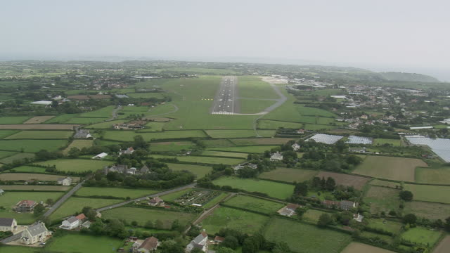 WS AERIAL View approaching towards runway of Airport / Guernsey, Channel Isles