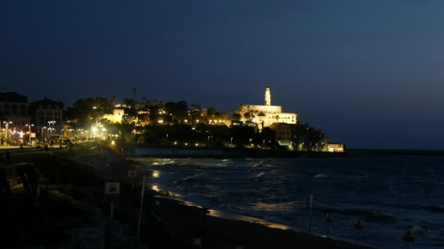 view at night of the old part of jaffa from the tel aviv promenade israel - jaffa stock videos & royalty-free footage