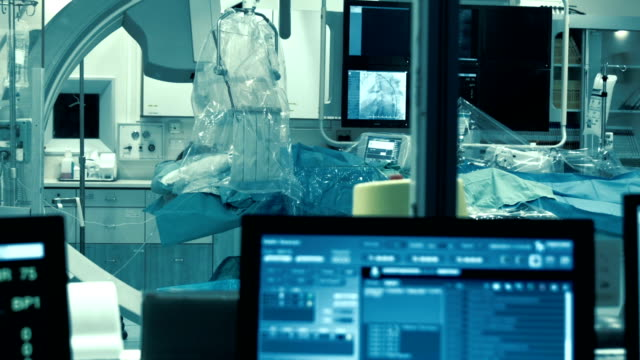 view at operating room through the window - operating theatre stock videos & royalty-free footage