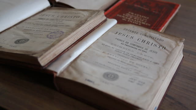view at the archive with old books in the xavier center of historical research founded by the jesuits on a table an old book with the title jesus... - christian ender stock-videos und b-roll-filmmaterial