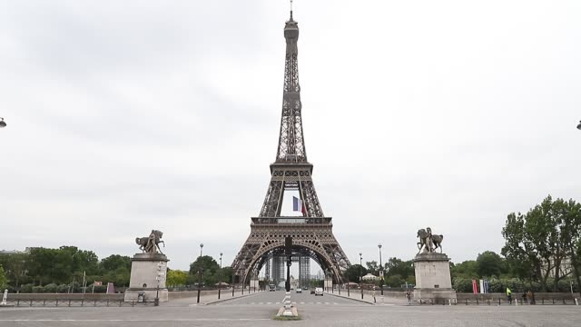 vídeos de stock, filmes e b-roll de view at the eiffel tower on the first day of a partial lifting of a near two month lockdown imposed in france to stop the spread of the pandemic... - tower