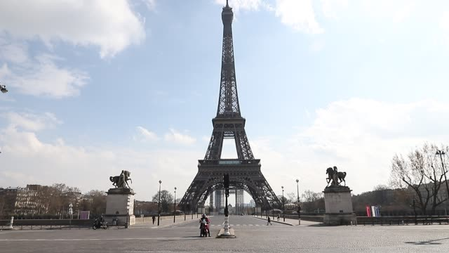 view at the eiffel tower on the second day after the announcement by french president emmanuel macron of the confinement of the french due to an... - famous place stock videos & royalty-free footage