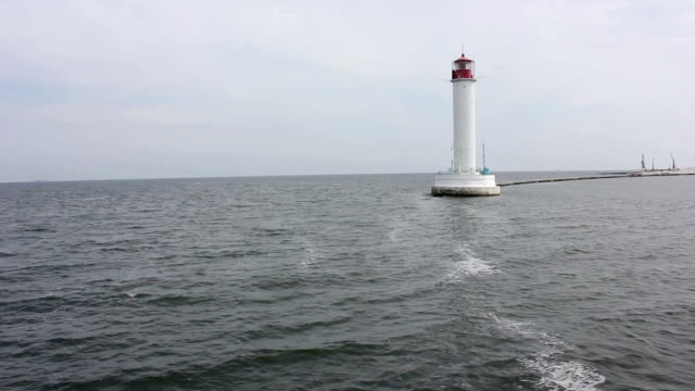 view at the lighthouse at the waterbreak from the see - entering stock videos & royalty-free footage