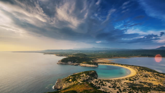 view at voidokilia beach from above. time lapse - greece stock videos & royalty-free footage