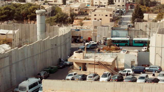 a view behind the west bank barrier at rachel's tomb walled off from bethlehem, palestine. - separation stock videos & royalty-free footage