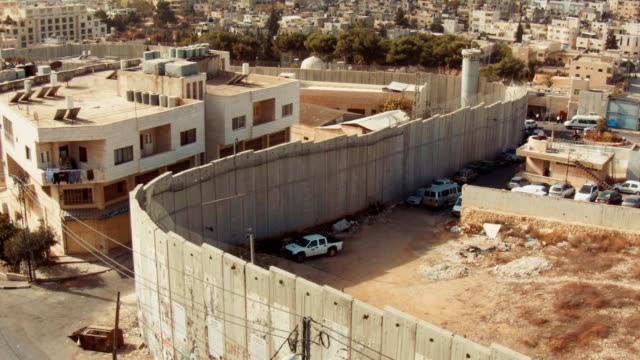 a view behind the west bank barrier close to rachel's tomb walled off from bethlehem, palestine. - palestinian territories stock videos and b-roll footage