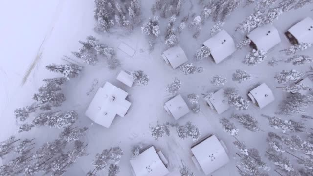 view by drone of torassieppi reindeer farm cabins covered in snow in winter, finnish lapland, finland, europe - frozen stock videos & royalty-free footage