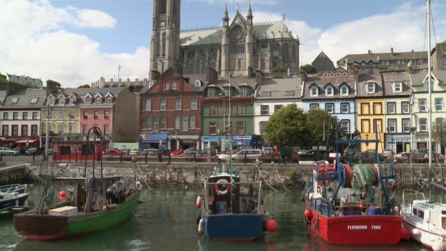 ms tu view colorful houses and boats in cobh harbour / cobh, county cork, ireland - county cork stock videos & royalty-free footage