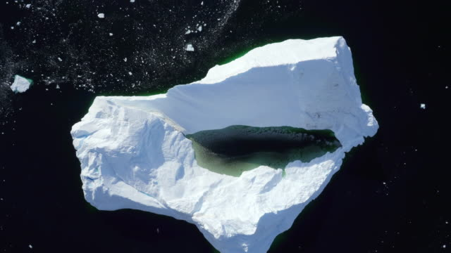 view directly above an antarctic iceberg - antartide video stock e b–roll