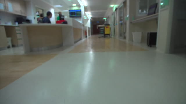 view down a hospital corridor and a close-up of a pulse monitor screen - israel stock videos & royalty-free footage