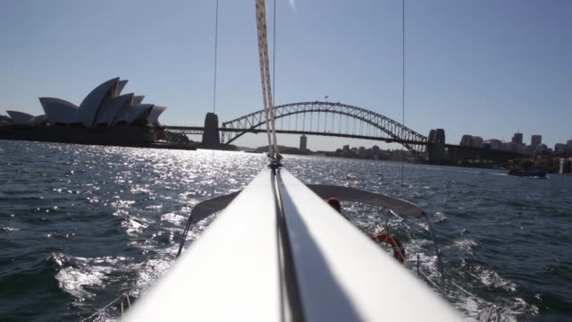 view down a sail boom on a cruise of sydney harbor with the harbor bridge in the background - surface level stock videos & royalty-free footage