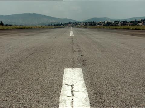 WS View down empty runway at Kigali International Airport / Kigali, Rwanda