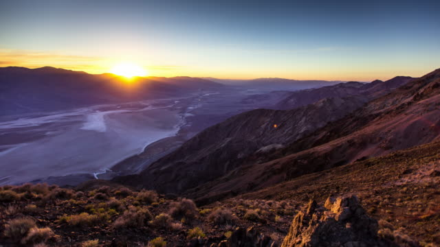 view down into death valley at sunset - time lapse - death valley national park stock videos & royalty-free footage