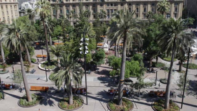 view down next to the metropolitan cathedral overlooking the sunny and green plaza de armas and the surrounding buildings, in santiago de chile. - surrounding stock videos & royalty-free footage