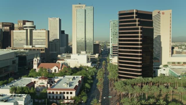 view down palm tree lined street in downtown phoenix - phoenix arizona stock videos & royalty-free footage