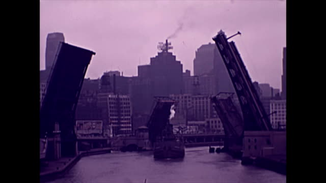 view down river to chicago skyline with bridges raised / the michigan avenue dusable bridge lifts / view of adjacent building / the american... - 1937 stock videos & royalty-free footage