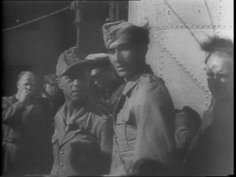 view down the barrel of artillery gun / british destroyer on patrol / small boatload of nazi prisoners boat coming alongside rescue ship / prisoners... - 1943 stock videos & royalty-free footage
