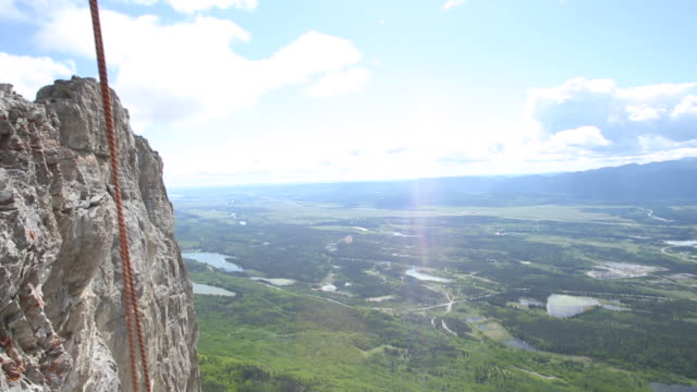 view down to climber's route and then up - rope stock videos & royalty-free footage