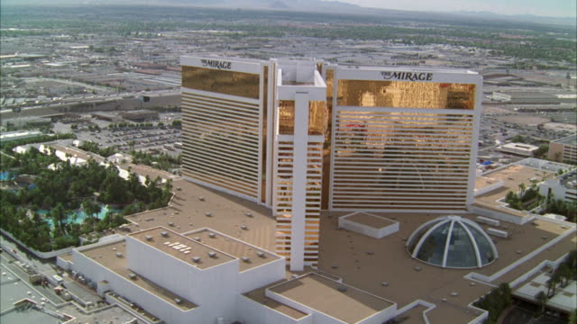 ws pov aerial view down to treasure island hotel then the mirage hotel / las vegas, nevada, usa - the mirage las vegas stock videos & royalty-free footage