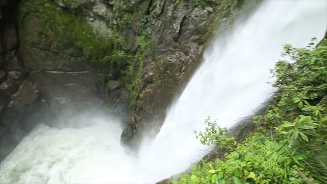 view downwards to waterfall and pools below - ecuador stock videos & royalty-free footage
