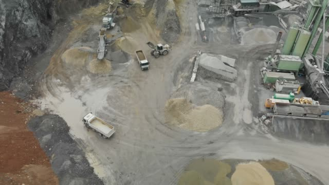 360 view, drone footage of an open-pit rock stone quarry in autumn - open cast mine stock videos & royalty-free footage