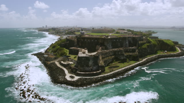 WS AERIAL POV View El Morro Castle and lighthouse near San Juan Bay / Old San Juan, San Juan, Puerto Rico, United States