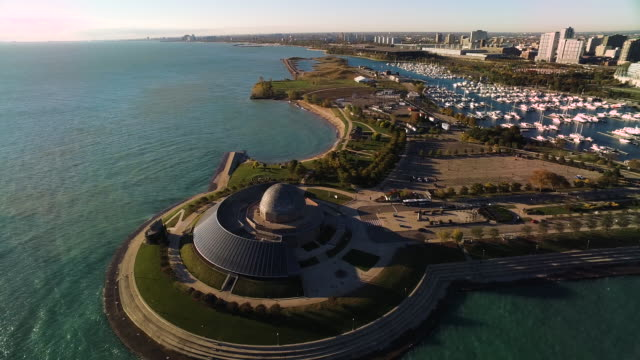 View facing south over Adler Planetarium, soaring over dome to Burnham Harbor