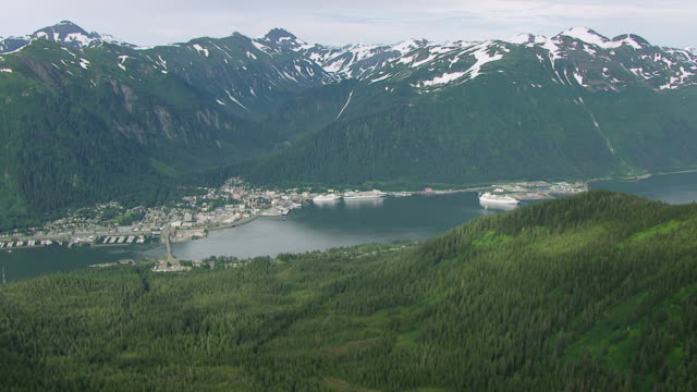 ws aerial view flying over douglas island mountain to juneau / alaska, united states - juneau stock videos and b-roll footage