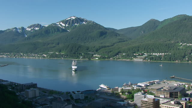 ws aerial pan view flying over forest to reveal downtown and waterfront with boats / juneau, alaska, united states - juneau stock videos and b-roll footage