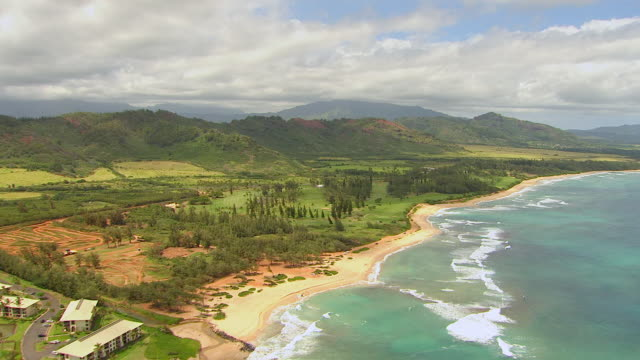 ws aerial view flying over island of kauai / hawaii, united states - isola di kauai video stock e b–roll