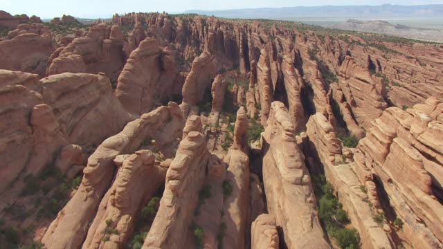 ws aerial view flying over klondike bluffs at arches national park / utah, united states - klondike stock videos and b-roll footage