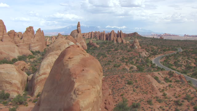 cu aerial view flying over klondike bluffs at arches national park / utah, united states - klondike stock videos and b-roll footage