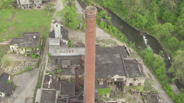 ms aerial view flying over old crow distilling company / kentucky, united states - distillery stock videos and b-roll footage