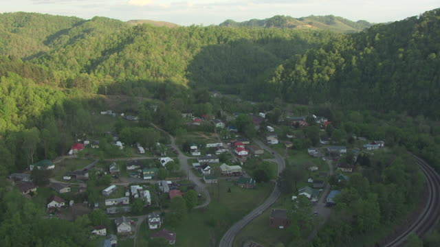 ws aerial view flying over town hatfield mccoy / west virginia, united states - hatfield stock videos and b-roll footage
